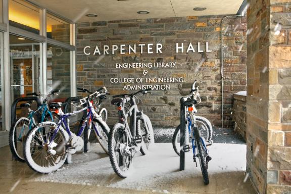 Bicycles in the snow outside of Carpenter Hall