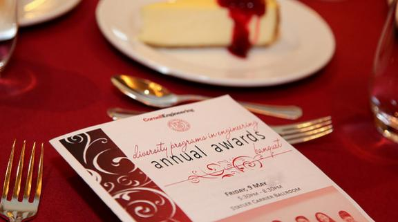 Awards Banquet program on a table with formal place setting