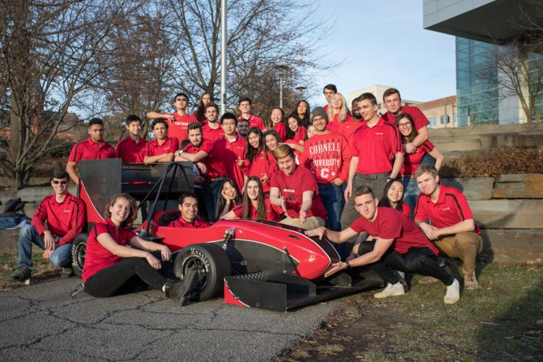 Members of Cornell Racing pose with their race car